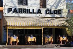 La parrilla Cloé (Ce Rey) Tags: parrilla asado argentina restaurant mesas sillas lugar place parrillada carne lugartípico palabras cartel letras toldo
