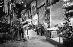 Old Market - Khan el-Khalili area (HoustonHVAC170) Tags: market street night vendor daily life seller rickshaw trader monochrome black white bw photography travel egypt cairo old town outdoors light