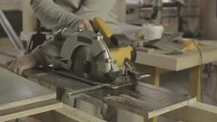 Carpenter cut wooden board on two parts by circular saw (SawAdvisor) Tags: circular saw woodworking carpenter cutting circularsaw