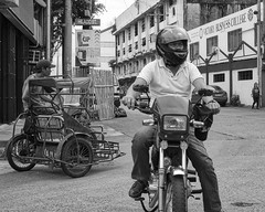 Checking (Beegee49) Tags: street man motorbike motorcyclist traffic blackandwhite monochrome bw luminar sony a6000 bacolod city philippines asia happyplanet asiafavorites