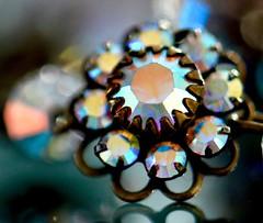 Upsy-daisy (helensaarinen) Tags: bling bokeh jewelry macromondays reflection macro daisychain