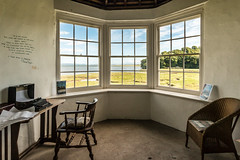 An inspiring room with a view (Keith in Exeter) Tags: carmarthenshire laugharne wales gazebo inspirational writing author view vista landscape castle window sea estuary water marsh tree woodland sky table chair typewriter richardhughes