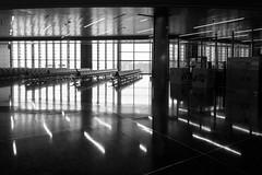Goodbye, Qatar (Torsten Reimer) Tags: airport asia doha reflections spiegelungen windows flughafen arabia seats katar fenster lighs reflektionen schwarzweis blackandwhite qatar monochrome qa