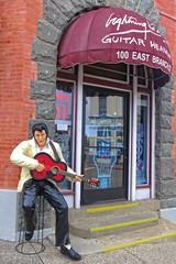 Looks Alive To Me!...☺ (Viejito) Tags: guitarheaven lightningjoe branchstreet bridgestreet nevadastreet arroyogrande california slo county usa unitedstates geotagged geo:lat=35123173 geo:lon=120579009 amerika amérique américa america canon powershot s100 canons100 guitar pick plectrum rickenbacker martin taylor fender gibson guild seagull yamaha ovation washburn ibanez epiphone schecter jackson gl black pants loafers steps store glass door brick wall elvis statue facial expression playing