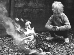 Start them early (theirhistory) Tags: child kid boy jumper trousers shoes burning bonfire