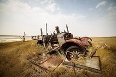 Devastation (TigerPal) Tags: saskatchewan sask prairies plains backroads exploration rural devastation truck antique rust rusty crusty abandoned forgotten sinking grass grassland glennbain ruin outtopasture