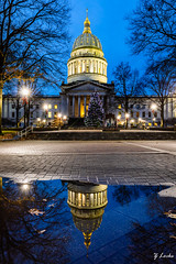 Capitol Reflection (zachary.locks) Tags: architecture blue brick bright building capitol charleston christmas dome empty golden hour lights orientation portrait puddle quiet reflection still tree vertical virginia water west wv zlocks almost heaven wild wonderful gotowv 52frames