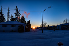 Last sunset for 2018 (darletts56) Tags: sky skylight cold winter clear last shine ray rays tree trees pole lamp post light snow home homes house houses silhouette prairie saskatchewan canada sun sunset dusk evening night road highway line wire power decorations lights yellow orange white blue pink gold golden country