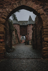 Uphill to the castle (*M.*) Tags: castle gate arch germany towers rainy architecture travel
