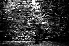 Faster than the speed of light (Leica M6) (stefankamert) Tags: film analog analogue grain wall textures highcontrast motionblur blur blurry stones people running speed leica m6 leicam6 kodak trix voigtländer ultron blackandwhite blackwhite noir noiretblanc dark mood