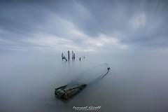 Sinking (ismaguell) Tags: largaexposicion londexposure seascape sunrise amanecer deltebre barca boats