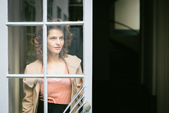 Window shopping (dawolf-) Tags: woman stairs door glass reflection portrait actress headshot naturallight outdoor house doorway shadow curls pinktop rasterized pattern canon vienna backyard