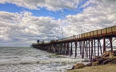 O'Side Pier 18-2-20-19 (rod1691) Tags: oceanside california rainday clouds pier surf beach rocks canon 50d