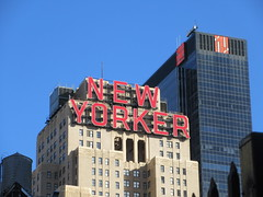 2019 New Yorker Building Sign NYC 4208 (Brechtbug) Tags: new yorker building sign 34th street nyc 2019 york city pulp fiction characters movie wall peeling film posters traffic taxi cab ad advertisement pop popular art mural american flag blue sky billboards empire state