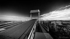 Carbridge In The Deep (Alfred Grupstra) Tags: blackandwhite transportation sky outdoors railroadtrack travel nopeople cloudsky bridgemanmadestructure road vanishingpoint architecture landscape journey monochrome sunset nature street 936 carbridge harbour