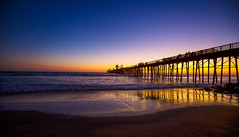 Time Is the Fire In Which We Burn (KC Mike Day) Tags: socal ocean pacific water sea sunset cloud yellow orange distance california west coast oceanside wooden waves light sand beach