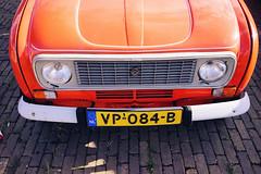 Renault 4 in orange (Eric Flexyourhead) Tags: ndsm ndsmwerf nederlandschedokenscheepsbouwmaatschappij amsterdamnoord amsterdam netherlands holland nederland city urban detail fragment car french renault r4 renault4 orange vibrant vivid sonyalphaa7 zeisssonnartfe35mmf28za zeiss 35mmf28