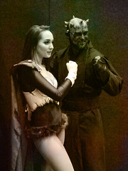 First to the Punch (Steve Taylor (Photography)) Tags: glove punch pose cloak digitalart picture portrait brown man woman lady newzealand nz southisland canterbury christchurch addington armageddonexpo armaggedon costume darthmaul horns outfit starwars antique sepia