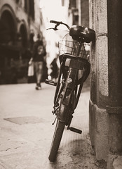 Leaning bicycle (Matthew Johnson1) Tags: 14 2019 arches bicycle blackandwhite blur city dof february florence italy leaning outdoors pavement peddle person pisa street wheels