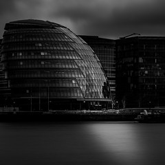 Shine bright like a... (Aleem Yousaf) Tags: gla greater london authority mayour office architecture monochrome black white long exposure lee big stopper overcast clouds sky sunset reflections river thames water more digital camera nikon nikkor 70200mm telephoto photography light shadows flags