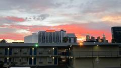 Sunset Over ~ Las Vegas, Nevada (1coffeelady) Tags: nevada nevadasunset nevadaevening sunset evening colors babyblue bluepurple red orange yellow white clouds eveningcolors sunsetcolors nevadaroadtrip lasvegasnevada scenery skyline buildingsandthesunset lights