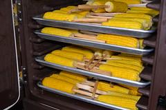 Racked Up (amslerPIX) Tags: planetkids guatemala corn cob food meal yellow warming rack trays