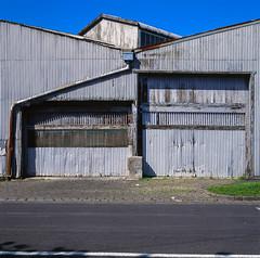 West Melbourne (Westographer) Tags: westmelbourne victoria australia westernsuburbs industrial corrugatediron lines corrugatedironsheds film fujivelvia transparency mediumformat 6x6