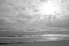 Low Tide Cloud Break (brucetopher) Tags: beach sea light sunlight ocean cloud cloudscape sun morning sunrise beauty water shimmer shiny shine sunshine ray rays reflect reflection sunray rayofsunshine black white blackandwhite bw blackwhite monochrome mono bnw breaker breakers wave waves crash crashing