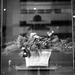 untitled (kaumpphoto) Tags: rolleiflex 120 tlr ilford bw black white street urban city window display arrangement minneapolis pine needles ribbon berries greenery holiday christmas ornaments candle reflection