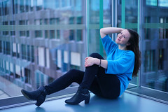 Chameleon (Nathalie_Désirée) Tags: businessbuilding glass stuttgart girl ndm boot boots winter smile blue happy style longhair march indoor indoors shooting sonyα sonyαmo sonyamo sonyalpha7rii sonyalpha7r2 canon50mm f18 nice blueeyes cloudy turquoise cyan architecture window windows pullover blackjeans sit sitting paleskin bracelet leather calm relax relaxed serene city human female young person urban sonyαtrice sonyatrice