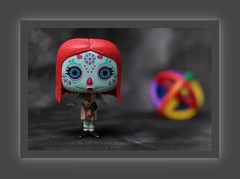 'Day of the Dead' Sally (N.the.Kudzu) Tags: tabletop toy funkopop dayofthedead sally puzzle canondslr lensbabyedge50 photoscape frame home
