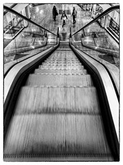 082 Escalator (georgestanden) Tags: blackandwhite black white monochrome desaturated photo photography photograph bnw iphone mobile mobilephone iphonephotography iphonephoto iphonephotographer art picture photooftheday blackwhite shopping shop shops salford salfordquays manchester city abstract precinc mall steps stairs lowryoutletmall lowry iphone6s people