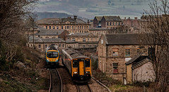 Coming and going at Dewsbury (Peter Leigh50) Tags: dmu diesel multiple unit class 150 165 town townscape building stone train trees track railway railroad rail fujifilm fuji xt2
