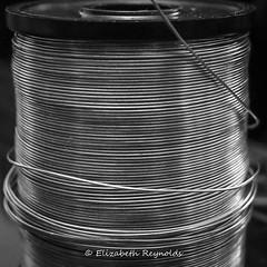 Day 81. (lizzieisdizzy) Tags: monochrome mono monotone monochromatic chromatic chroma tabletop reel wire narrow thin spool fuse craft cylindrical cable tape bobbin spindle blackandwhite blackwhite black shades grey
