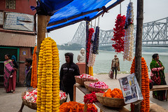 Riverside (SaumalyaGhosh.com) Tags: riverside ganga ganges india howrahbridge color colour fuji fujifilm xt2 people flowers water