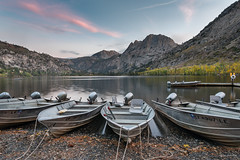 Sunset at Silver Lake (madrones) Tags: fallcolor landscape aspen mirror sierranevada mountains lake weather clouds northerncalifornia california unitedstatesofamerica colorful fishing junelakeloop silverlake easternsierra color sunset boat nature fishingboat pink northamerica autumn ca colour dusk fallfoliage foliage monocounty tree trees twilight usroute395 us395 usa junelake us
