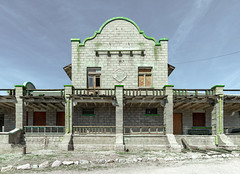 Las Vegas and Tonopah Railroad Depot in Rhyolite, NV (Gentilcore) Tags: 1909 architecture beatty bullfroghills deathvalley depot desert ghost ghosttown green historic lasvegas nevada nyecounty old park rhyolite rock rustic station stone tonopah travel visit wesanderson western white williamaclark abandoned boom brick bust desaturated designed early gray igneous lightblue mining national pale pallette railroad remains site spanish style supposedly town usa
