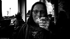 The Dark Side Of Devon. (Neil. Moralee) Tags: neilmoralee teignmouthdevonneilmoralee woman lady tea cream jan scone devon cornwall eating smile glasses mature british creamtea dark dim contrast art olympus omd em5 neil moralee teignmouth uk food face portrait harsh ring rings jewelery power soul cafe window