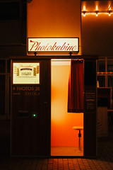 Photoautomat in Berlin (Luca Quadrio) Tags: photo curtain portrait automatic machine old germany cabin oldfashioned filmstrip red modern vintage photostrip picture street sign travel retro photography camera shot berlin photoautomat europe analog image berlino de