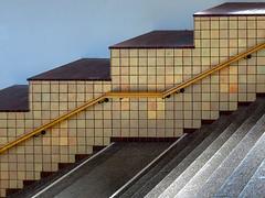 Golden tiles (Ulrich Neitzel) Tags: architecture architektur geländer golden hamburg handrail interior lines linien mzuiko1250mm metro olympusem5 stairs tile treppe kachel gefliest hochbahn saarlandstrase