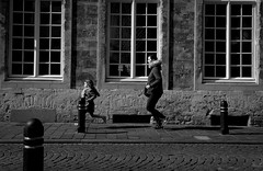 Don't be late and .... run (Phil*ippe) Tags: blackwhite black white ghent gent run running child woman window