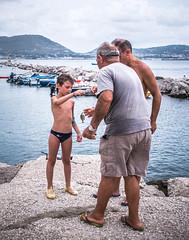 fishing lessons (FedeSK8) Tags: campania campaniafelix fedesk8 federicoscottophotography fujifilmxm1 italia italy fedescotto bacoli people