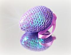 Shimmering Egg (Through Serena's Lens) Tags: smileonsaturday minimaleggtic egg minimalist minimalism reflection sequins shimmering mirror ribbon ornament dof tabletop canoneos6dmarkii closeup bokeh