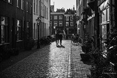 Shopping is cheaper than therapy (Peter Jaspers) Tags: frompeterj© 2019 olympus zuiko omd em10 1240mm28 contrast bw bn blackwhite leiden netherlands holland street streetphotography winter shadows