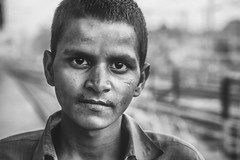 train platform meeting (andy_8357) Tags: portrait portraiture street sony a6000 alpha ilcenex ilce6000 young man train platform varanasi 6000 emount sigma 60mm f28 dn art bw black white blanco y negro blanc et noir monochrome meeting authentic intense honest simple eyes eye contact prime lens mirrorless heart bokeh dof shallow intent