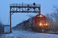 Blizzard on the B&LE (bobchesarek) Tags: trains railroad winter blizzard snow oretrain hoppers cn blerr ble signalbridge railroadsignals bluehour bessemerlakeerie