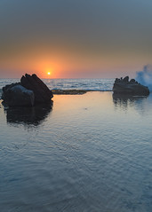 Sunrise Seascape, Splash and Rocks (Merrillie) Tags: daybreak wamberalbeach sand sunrise centralcoast morning cloudy australia sea surf overcast wamberal weather newsouthwales waves earlymorning nsw sky beach ocean landscape clouds waterscape coastal dawn outdoors seascape nature coast water seaside