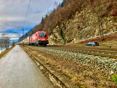 ÖBB freight train between Kufstein and Kiefersfelden passing the river Inn (UweBKK (α 77 on )) Tags: öbb österreich freight train rail railway transport river inn path road hike clouds grey red kiefersfelden kufstein tyrol tirol austria europe europa iphone