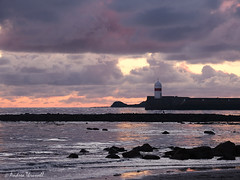 Sunset Harbour (manxmaid2000) Tags: sunset harbour beach sea rocks reflection water wet sand castletown isleofman manx iom fuji ocean rock bay seascape weather clouds lighthouse pink orange irishsea scarlett cloudscape cold winter layered storm