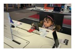 The little  geek (Jean-Louis DUMAS) Tags: geek smartphone little girl portrait informatique computer phone game people gamer jeu ordinateur portable